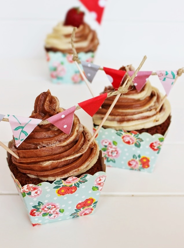 Chocolate Vanilla Swirl Cupcakes made with chocolate cupcakes, then frosted with vanilla and chocolate swirled frosting, And topped with cute mini bunting.