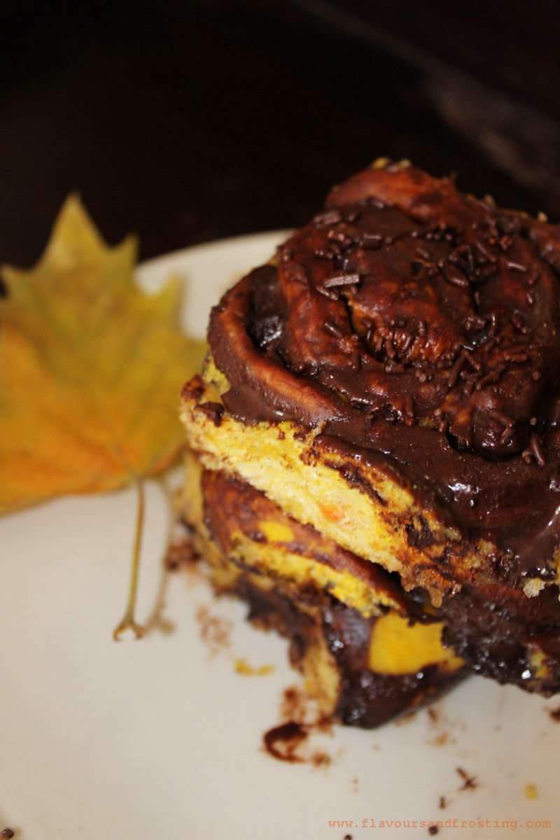 Homemade Pumpkin Cinnamon Rolls with a chocolate glaze