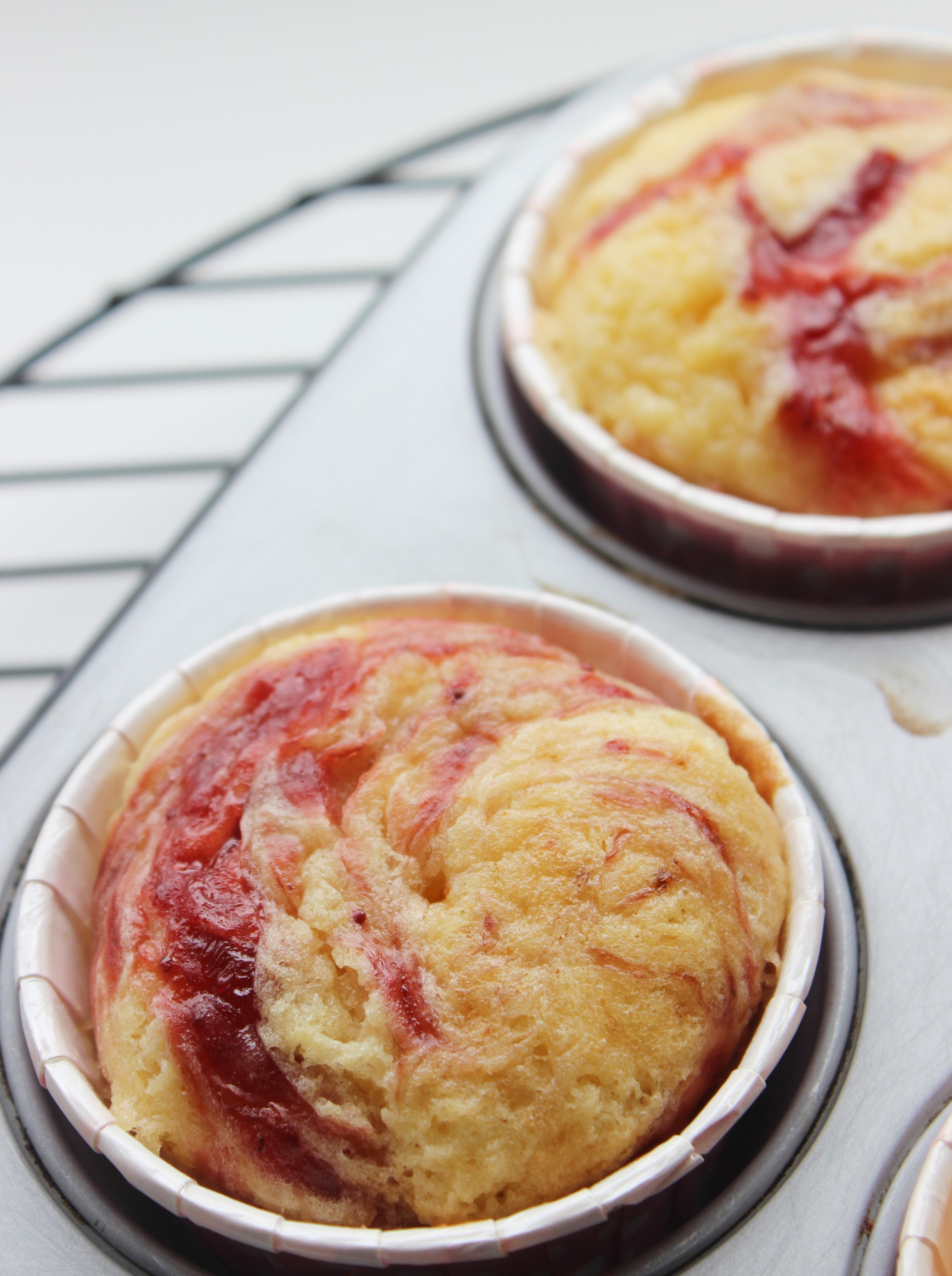 Vanilla Buttermilk Cupcakes with strawberry preserve swirl