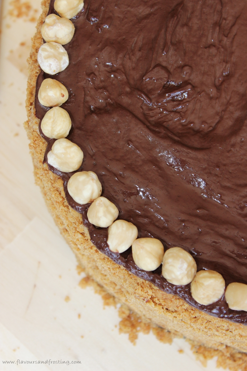 baked coffee cheesecake on a cookie and hazelnut crust, topped with dark chocolate ganache