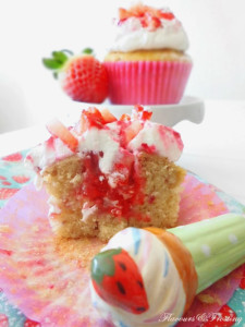 Strawberry Cupcakes topped with whipped cream