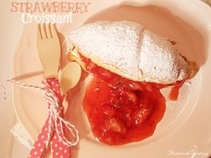 strawberry sauce on a croissant