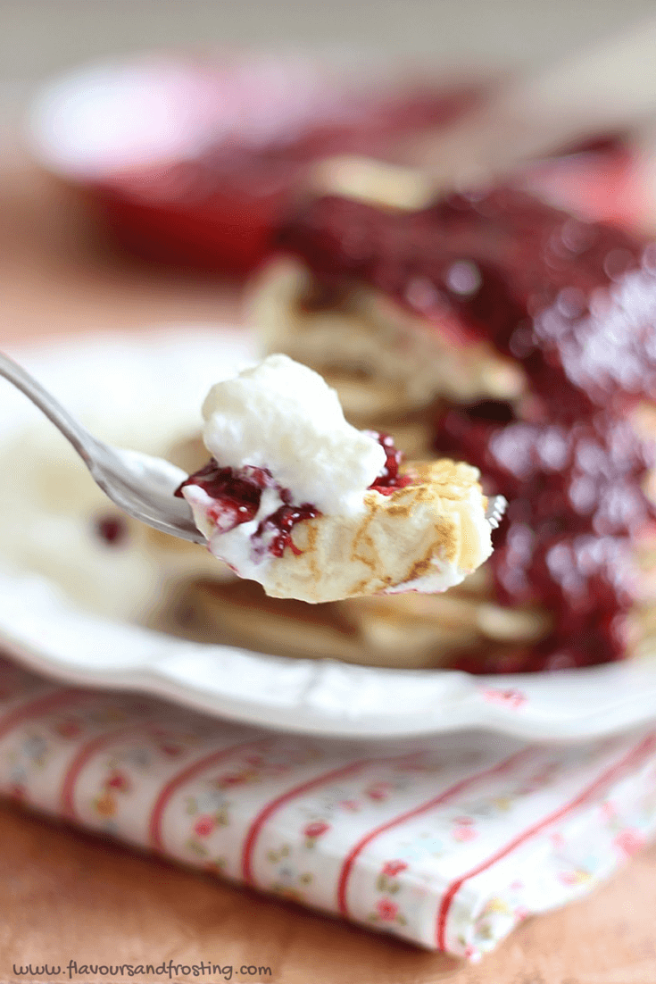Raspberry Pancakes also called Raspberry Crepes made with Homemade Raspberry Sauce