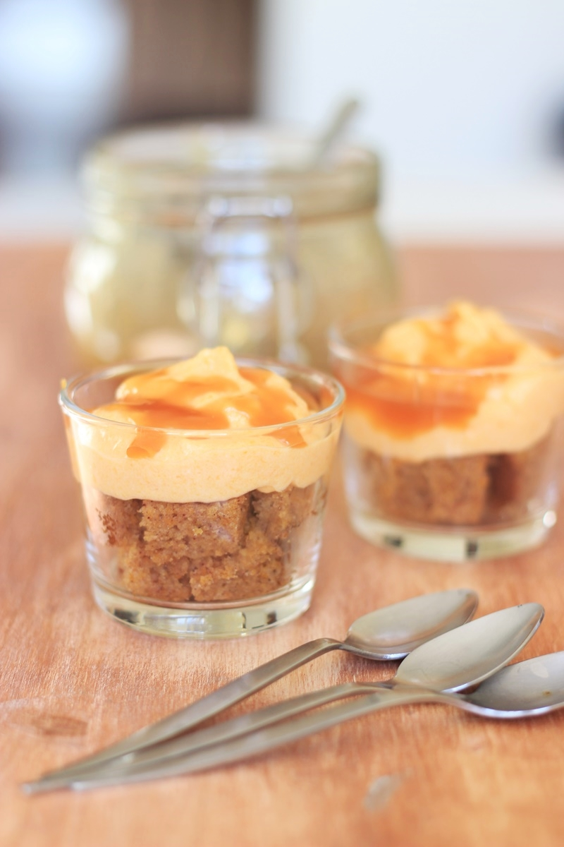 Easy Salted Caramel Pumpkin Cheesecake Parfait made with homemade salted caramel sauce, pumpkin cream cheese, pumpkin spice bundt cake and topped with freshly whipped cream.