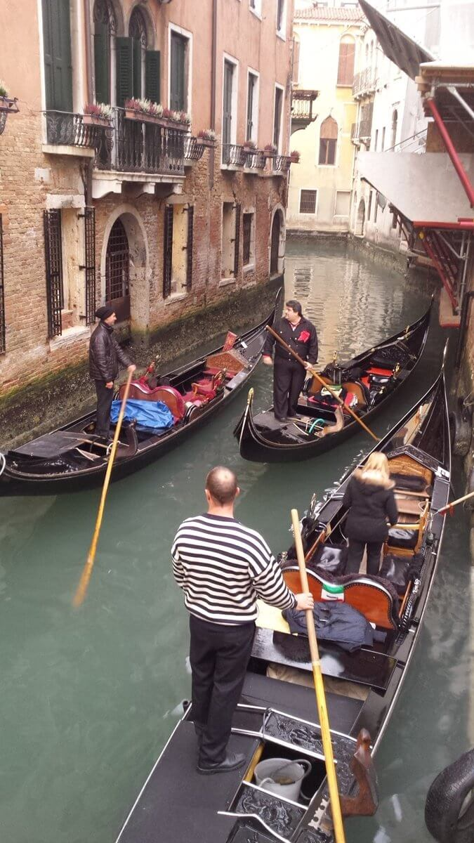 Tourist attractions in Venice. Punting in Venice on a Gondola.