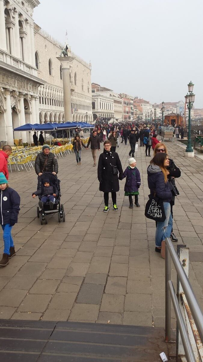 Tourist attractions in Venice Italy. Getting off the Vaporetto, walking towards Piazza San Marco.